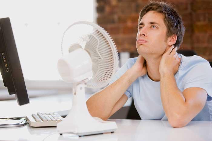 summer heat - man in front of fan illustration